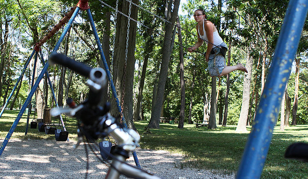 Salem: Cortney Hillier, of Salem enjoys the swings at Forest River Park in Salem on a gorgeous sunny July day. Photo by David Le/Salem News