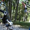Salem: Cortney Hillier, of Salem enjoys the swings at Forest River Park in Salem on a gorgeous sunny July day. Photo by David Le/Salem News