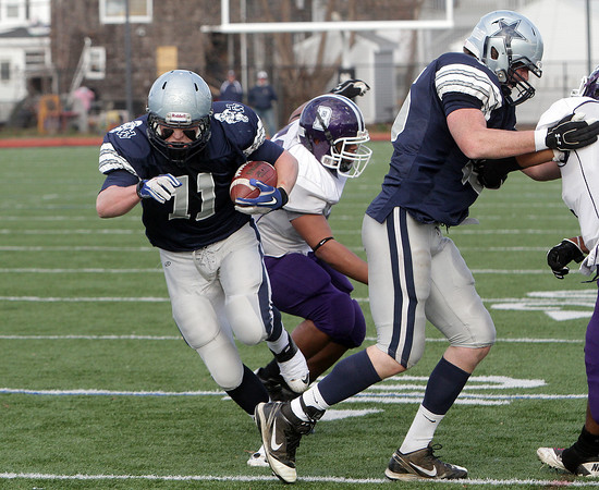 Hamilton-Wenham's Luke Wendt (11) uses a block from Taylor Drinkwater (55) right and scampers into the endzone for a successful two-point conversion against Bourne High School on Saturday afternoon. David Le/Salem News