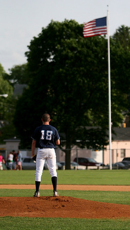Danvers: Danvers High School starting pitcher, Scott Hovey, salutes the flag during the National Anthem at the Woodman Baseball Tournament Championship held over Memorial Day Weekend. Photo by David Le/Salem News
