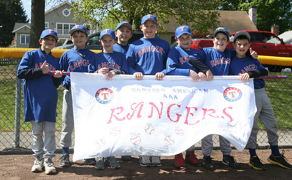 The Rangers of AAA Danvers American Little League pose for a photo after the Opening Day Parade on Saturday. David Le/Staff Photo