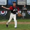 Marblehead third baseman Derek Marino fires the ball to first to throw out a Peabody runner on Tuesday evening.