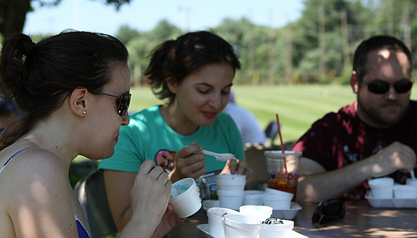 Danvers: From left, Andrea Schuler, Jennie Murack, and Rich Carey, of Swampscott, enjoy a sampling of different ice creams at the 8th Annual Scoop-Ah-Bowl, held at Danvers High School on Saturday afternoon. Photo by David Le/Salem News