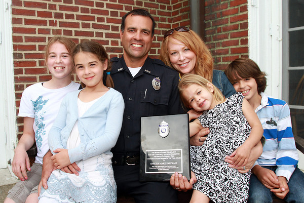 Beverly Police Officer of the Year Marc Panjwani, and his wife Rebecca, sit with their children from left, Savannah, 11, Tatum, 7, Cali, 4, and Harrison, 9, after Panjwani was presented the award on Tuesday afternoon. David Le/Staff Photo