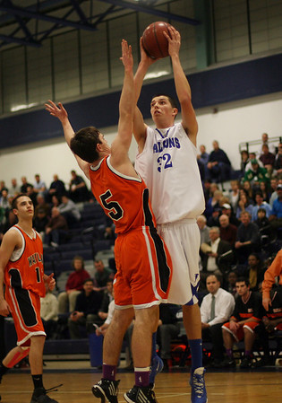 Danvers senior George Merry (32) right, rises up over Wayland's Mark Bonner (5) left, to hit a jump shot. David Le/Staff Photo