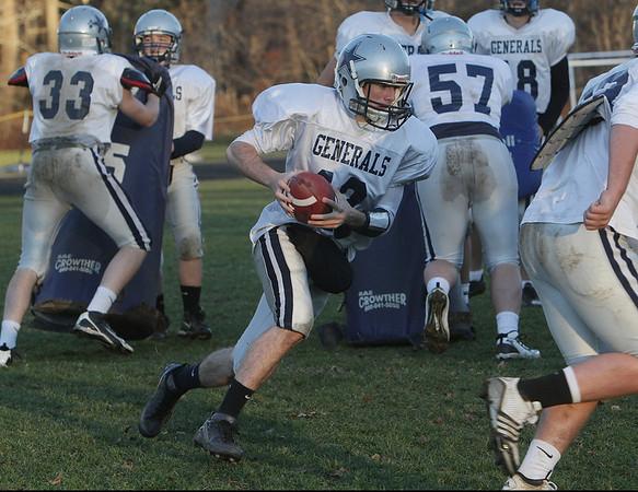 Hamilton-Wenham quarterback Trevor Lyons bootlegs at practice. David Le/Salem News