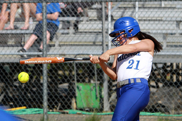 Danvers High School senior catcher Samantha DiBella makes sharp contact off Dracut pitcher Lauren Ramirez on Sunday afternoon. David Le/Staff Photo