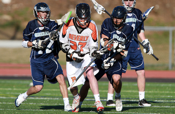 Beverly attacker Matthew Page (27) center, weaves through a crowd of Hamilton-Wenham defenders on Friday afternoon. David Le/Staff Photo