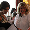 Middleton: Lisa Andriotakis, left, and Sally Cooper, both of Boxford, look at the gift baskets that were raffled off during the Boxford Town Libraries Annual Spring Luncheon held at Angelica's Restaurant in Middleton on Thursday afternoon. Photo by David Le/Salem News
