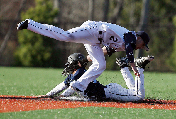 Peabody's Bobby Losano gets tagged out trying to steal at secondbase by St. John's Prep shortstop Tommy Buonopane to end the top of the 6th inning. David Le/Staff Photo