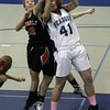 Beverly's Erin Silvestri (12) left, and Peabody's Olivia Summit (41) battle for a rebound. David Le/Salem News