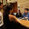 Hawthorne Hotel front desk employees Jessica Herrick right, and Melissa Kelly, left, check in guests Jenny Moor and Jamien McCullum, of San Francisco, CA, on Friday afternoon.David Le/Staff Photo