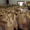Full bags of food sat waiting for families to pick them up on Saturday afternoon at St. Joseph's Food Pantry on Highland Ave in Salem. David Le/Salem News