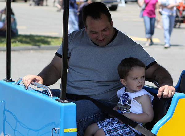 Danvers: Robert Dedominicis, left, shares a ride with his son Hunter, at the Touch-a-Truck Day, held as part of the Family Festival at the Liberty Tree Mall in Danvers. Photo by David Le/Salem News