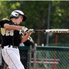 Bishop Fenwick's Cam Borelli makes contact off Lynnfield on Thursday afternoon. David Le/Staff Photo