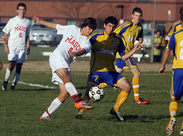 Masco's Michael Ennis (8) left, crosses the ball to a teammate while being pressure by Acton-Boxborough's David Lush on Wednesday afternoon. David Le/Salem News