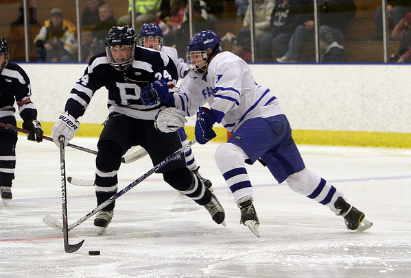 Beverly: Peabody's Nick Salalayko controls the puck against Danvers' Nick Strangie on Saturday afternoon. David Le/Salem News
