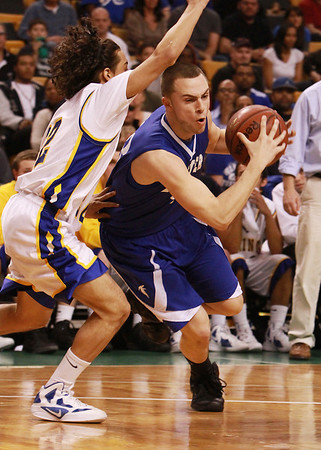 Danvers junior Nick McKenna (23) drives to the hoop past a Wareham defender on Monday at the TD Garden. David Le/Staff Photo