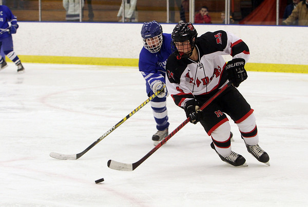 Marblehead's Cam Rowe (4) right, controls the puck while being pursued by a Danvers defender. David Le/Salem News