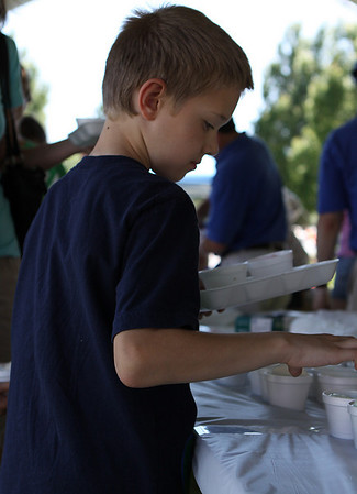 Danvers: Hayden Knight, 7 of Danvers, chooses from a selection of ice cream offered at the 8th Annual Scoop-Ah-Bowl held on Saturday afternoon at Danvers High School. Photo by David Le/Salem News