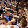 The Danvers High School players and fans celebrate their school's first D3 Basketball State Championship together following a victory over St. Joseph's on Saturday afternoon. David Le/Staff Photo