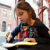 Ava Carter, 7, of Saugus, paints her clay butterfly at Clay Dreaming Pottery Studio on Wednesday. David Le/Staff Photo