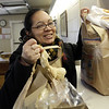 Aneyda Tiburcio, of Salem, picks up a few bags of groceries at St. Joseph's Food Pantry on Saturday afternoon. David Le/Salem News