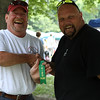 Danvers: Paul Chisholm, left, of Danvers is congratulated by Scott James for Chisholm's third place finish in the Commercial Class at the first Endicott Park Day Chili Contest, held Saturday afternoon. Photo by David Le/Salem News