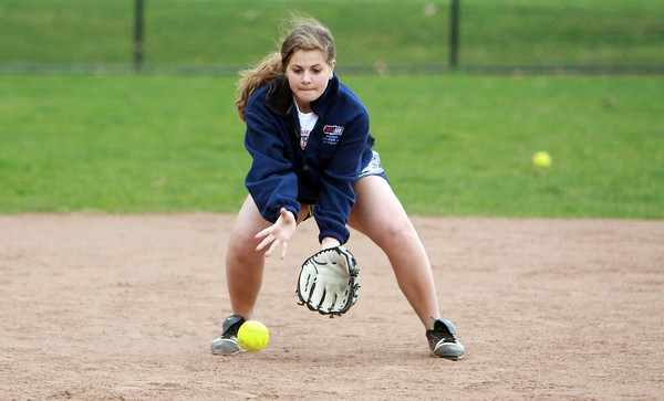 Pingree senior Shelby DiFiore fields a ground ball during infield practice on Wednesday. David Le/Staff Photo