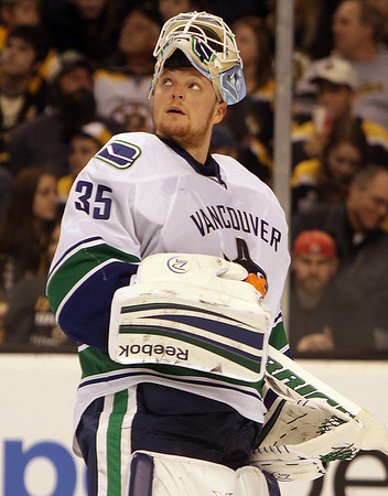 Marblehead native and Vancouver Canucks goalie Cory Schneider glances up at the scoreboard during the third period of the Canucks game against the Bruins. The local stopped 36 shots in a winning effort for the visiting Canucks. David Le/Salem News