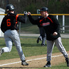 Beverly's Alex Toomey gets a congratulatory first bump from third base coach Joel Belmonte following his first inning home run. Toomey's homer was the only offense Beverly could muster against Peabody starter Pat Ruotolo on Wednesday afternoon. David Le/Staff Photo