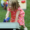Charlotte Lockerbie, 3, of Beverly, plays bags at the Beverly Homecoming Lobster Festival at Lynch Park on Wednesday afternoon. David Le/Staff Photo