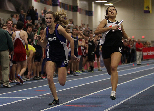Peabody anchor Sarah May, left, and Beverly anchor Wendi Marciano, right, battle to a photo finish in the 4x400 relay. David Le/Salem News