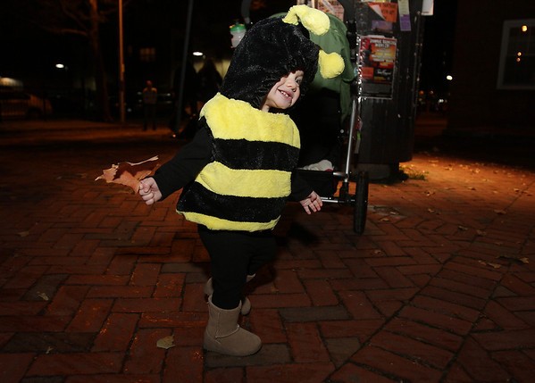 Audrey Gallagher, 1, of Salem, dressed as a bumble bee dances around on Halloween night. David Le/Staff Photo.