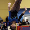 Danvers' Roni Levine flips backwards off the beam on. David Le/Salem News