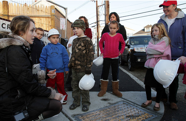 Jackie Giordano, of the North Shore Community Development Coalition talks with (from second left): Cameron Cook, 7, Tyler Cook, 5, Matthew Gribbins, 6, Lily Cook, 8, Plunge Captain for the Ayers School, Courtney Cook (behind), and Caroline, 7, and Debbie Ploszay about the affordable housing located at the Holcroft Park Homes on Mill St. David Le/Salem News
