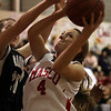 Masco's Nicole Femino (4) gets fouled as she goes up for a layup. David Le/Salem News