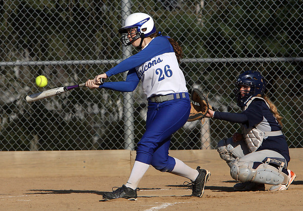 Danvers first baseman Devyn Downs makes contact against Swampscott on Friday afternoon. David Le/Staff Photo