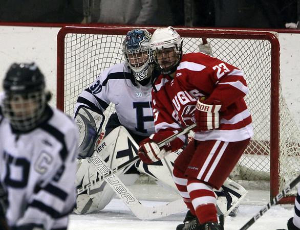 Peabody goalie Joe Powers peers around the screen of a Saugus player on Wednesday night. David Le/Salem News
