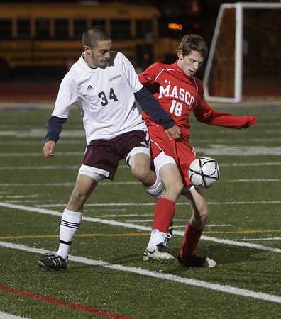 Masco's Justin Clark (18) controls the ball against Ludlow's Jeff Danek (34) David Le/Salem News