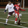 Masco's Justin Clark (18) controls the ball against Ludlow's Jeff Danek (34) David Le/Salem News