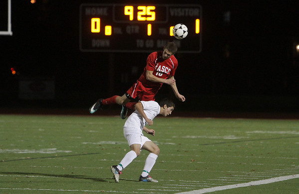 Masco senior Wes Shrewsbury (10) soars high over a Greater New Bedford player to win a head ball. The Chieftans defeated the Bears 2-0 on Tuesday evening in Weymouth. David Le/Salem News
