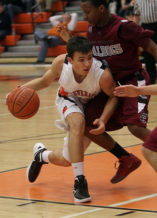 Beverly's John Berchoff (25) left, runs into a Lynn English defender on Friday night, David Le/Salem News