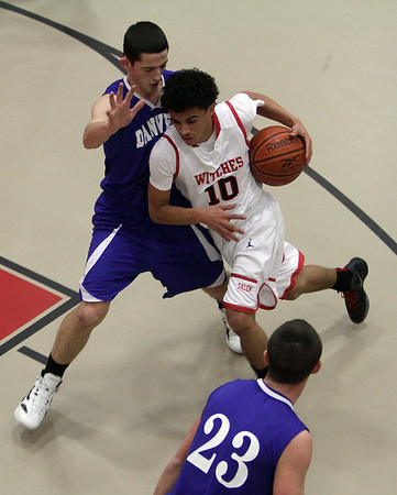 Salem's Marvin Baez (10) right, drives to the hoop against Danvers' Eric Martin (11). David Le/Salem News