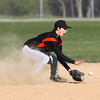 Beverly shortstop Brandon Sungy fields a ground ball in a cloud of dust against Peabody on Wednesday. David Le/Staff Photo