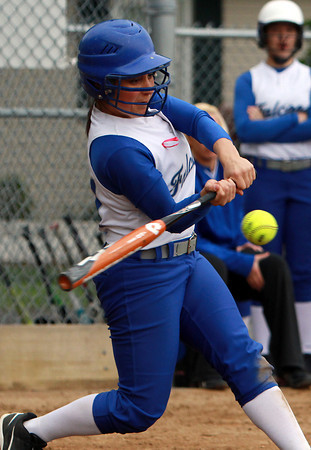 Danvers senior catcher Samantha DiBella ropes a base hit against Peabody on Wednesday afternoon. The Falcons downed the Tanners 5-2. David Le/Staff Photo