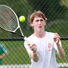 Beverly High School senior Zach Stone concentrates as he returns a volley against Austin Prep on Friday afternoon. David Le/Staff Photo
