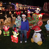 Ron Gagne, of Beverly, holds his granddaughter Abby Mahler, 5, of Portsmouth in his backyard which he lavishly decorates with lawn ornaments and lights. This is the 4th year he has decorated his yard. David Le/Salem News