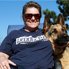 Sherry Grace, of Peabody, sits with her dog Brock at the Salem Dog Parkon Wednesday afternoon. David Le/Staff Photo