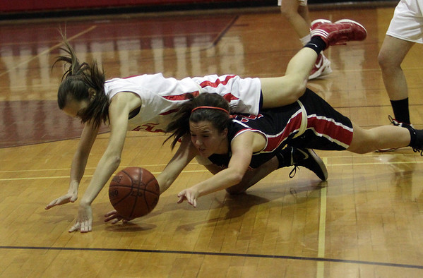 Topsfield: Masco's Meghan Collins (5) top, collides with a North Andover player as they scramble for the loose ball on Tuesday night. David Le/Salem News